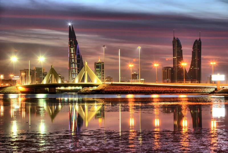Mandatory Credit: Photo by imageBROKER/REX/Shutterstock (1858916a) Skyline of the Corniche as seen from King Faisal Highway, Muharraq side, World Trade Center buildings, left, beside the towers of the Financial Harbour Complex, Muharriq Bridge at the Sheikh Isa Causeway, capital city, Manama, Kingdom of Bahrain, Persian Gulf VARIOUS