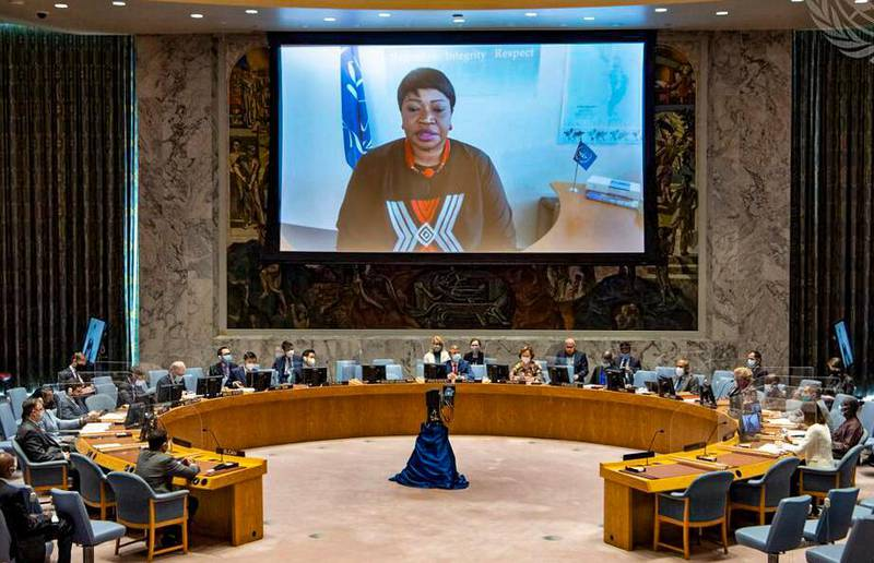 In this photo provided by the United Nations, International Criminal Court prosecutor Fatou Bensouda is shown on screen as she makes a virtual final address to the United Nations Security Council, Wednesday, June 9, 2021, at U.N. headquarters. (Eskinder Debebe/United Nations via AP)