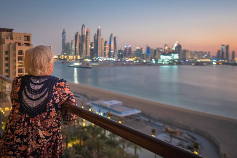 Rear View Of Woman Looking At City Buildings Against Sky in Dubai, United Arab Emirates. Getty Images