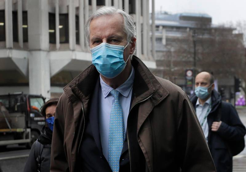 European Commission's Head of Task Force for Relations with the United Kingdom Michel Barnier wears a face mask to curb the spread of COVID-19 as he arrives at the Conference Centre in London, Friday, Dec. 4, 2020. With less than one month to go before the U.K. exits the EU's economic orbit, talks are continuing, and U.K. officials have said this is the last week to strike a deal. (AP Photo/Kirsty Wigglesworth)