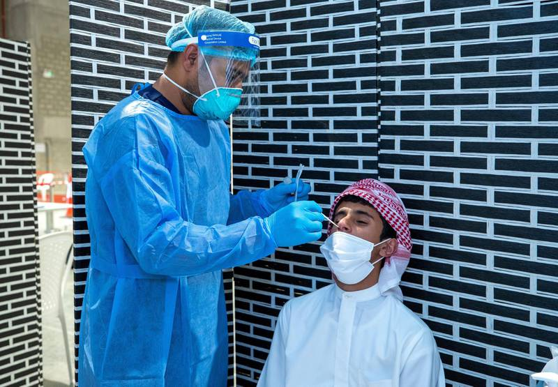 Abu Dhabi, United Arab Emirates, March 18, 2021.  Mohammed Almansoori  gets his PCR test at the Biogenix lab at G42 in Masdar City.Victor Besa/The NationalSection:  NAReporter:  Shireena Al Nowais