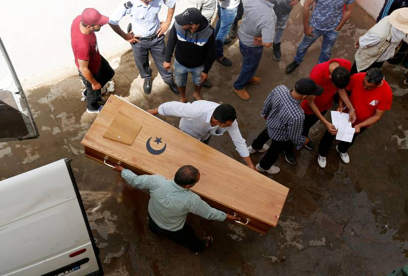 FILE PHOTO: Relatives carry a coffin containing the body of an immigrant who drowned when a boat sank, at a hospital morgue in Sfax, Tunisia June 4, 2018. REUTERS/Zoubeir Souissi/File Photo