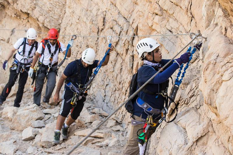 The region's first commercial Via Ferrata and UAE's largest outdoor zip line was put to the test when the CEO of Ras Al Khaimah Tourism Development Authority, Haitham Mattar, and Emirati adventurers Huda Zowayed and Hamad Al Mazrouey climbed, trekked and zip-lined the challenge set against the backdrop of Ras Al Khaimah's Jebel Jais, the UAE's highest mountain peak. Photo Credit Action PR Group *** Local Caption ***  bz24no-Rak-02.jpg