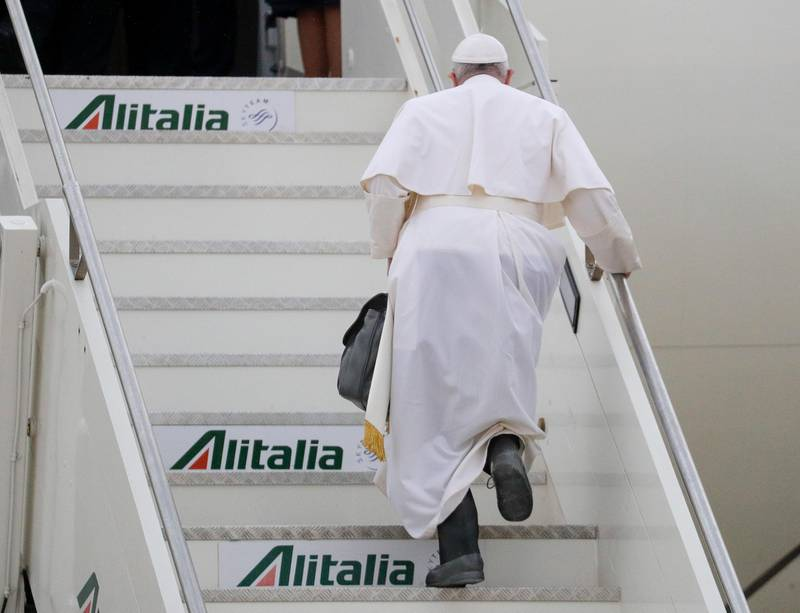 Pope Francis boards his plane as he leaves from Fiumicino's International airport Leonardo da Vinci, near Rome, for Baghdad, Iraq, Friday, March 5, 2021. Pope Francis is bound to Iraq for a four-day visit to urge the country's dwindling number of Christians to stay put and help rebuild the country after years of war and persecution, brushing aside the coronavirus pandemic and security concerns to make the first-ever papal visit. (AP Photo/Gregorio Borgia).