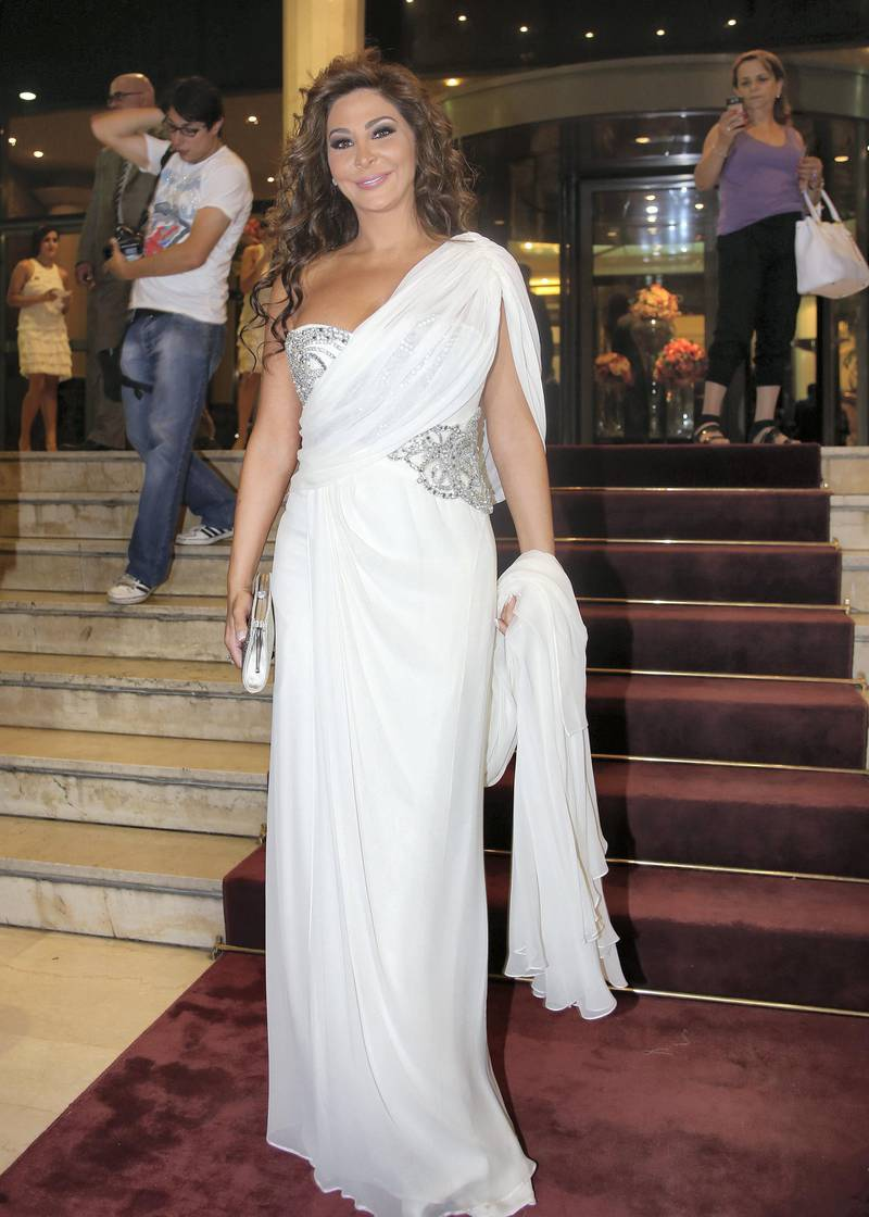Lebanese singer Elissa arrives for the 13eme Murex D'or Festival taking place at the Casino Du Liban, north of the capital Beirut, on June 23, 2013. AFP PHOTO/ANWAR AMRO (Photo by ANWAR AMRO / AFP)