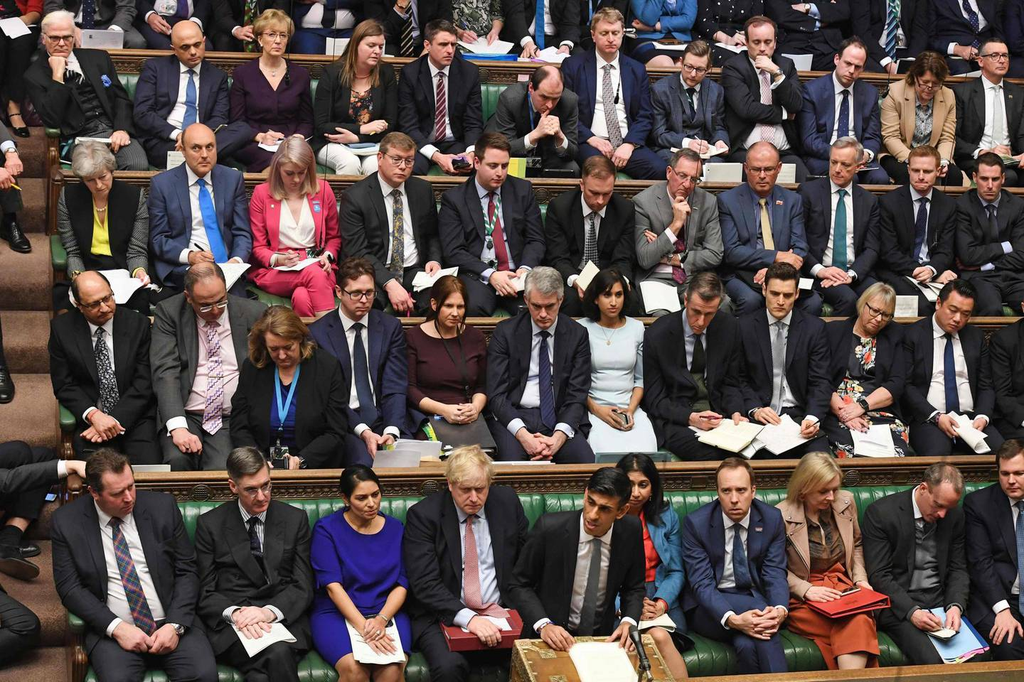 """A handout photograph released by the UK Parliament shows Britain's Chancellor of the Exchequer Rishi Sunak (centre bottom row) delivering his 2020 Spring budget statement in the House of Commons in London on March 11, 2020.  Britain unveils its first post-Brexit budget on Wednesday, with a focus on emergency government funding measures to combat economic fallout from the coronavirus outbreak. - RESTRICTED TO EDITORIAL USE - NO USE FOR ENTERTAINMENT, SATIRICAL, ADVERTISING PURPOSES - MANDATORY CREDIT """" AFP PHOTO / Jessica Taylor /UK Parliament""""  / AFP / UK PARLIAMENT / JESSICA TAYLOR / RESTRICTED TO EDITORIAL USE - NO USE FOR ENTERTAINMENT, SATIRICAL, ADVERTISING PURPOSES - MANDATORY CREDIT """" AFP PHOTO / Jessica Taylor /UK Parliament"""""""