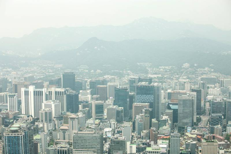 SEOUL, SOUTH KOREA - JUNE 25: The aerial view of downtown Seoul on June 25, 2018 in SEOUL, South Korea. Over 66,000 South Koreans have been separated from their families during the Korean War which started on June 25, 1950, and effectively split the Korean Peninsula into two over the 3-year conflict. The fighting between North and South Korea ended on July 27, 1953, with the signing of the Korean Armistice Agreement and the heavily guarded Demilitarized Zone was created; however, both countries remain technically still at war since no peace agreement was signed and many Koreans died before they could reunite with their loved ones. As tensions begin to ease between North and South Korea since early this year, both sides agreed on Friday in allowing families who were separated during the Korean War to meet in August, the first such reunions since 2015. North Korean officials also recently announced they will return the remains of as many as 200 American troops from the war to the U.S., the first sign that the totalitarian nation plans to comply with an agreement signed on June 12 by North Korean leader Kim and U.S. President Trump, during a historic summit in Singapore. Diplomatic relations between the two Koreas have warmed rapidly since early this year when North Korea sent athletes into the South for the PyeongChang Winter Olympics and people cautiously wait for further the peace talks between the Koreas. (Photo by Jean Chung/Getty Images)