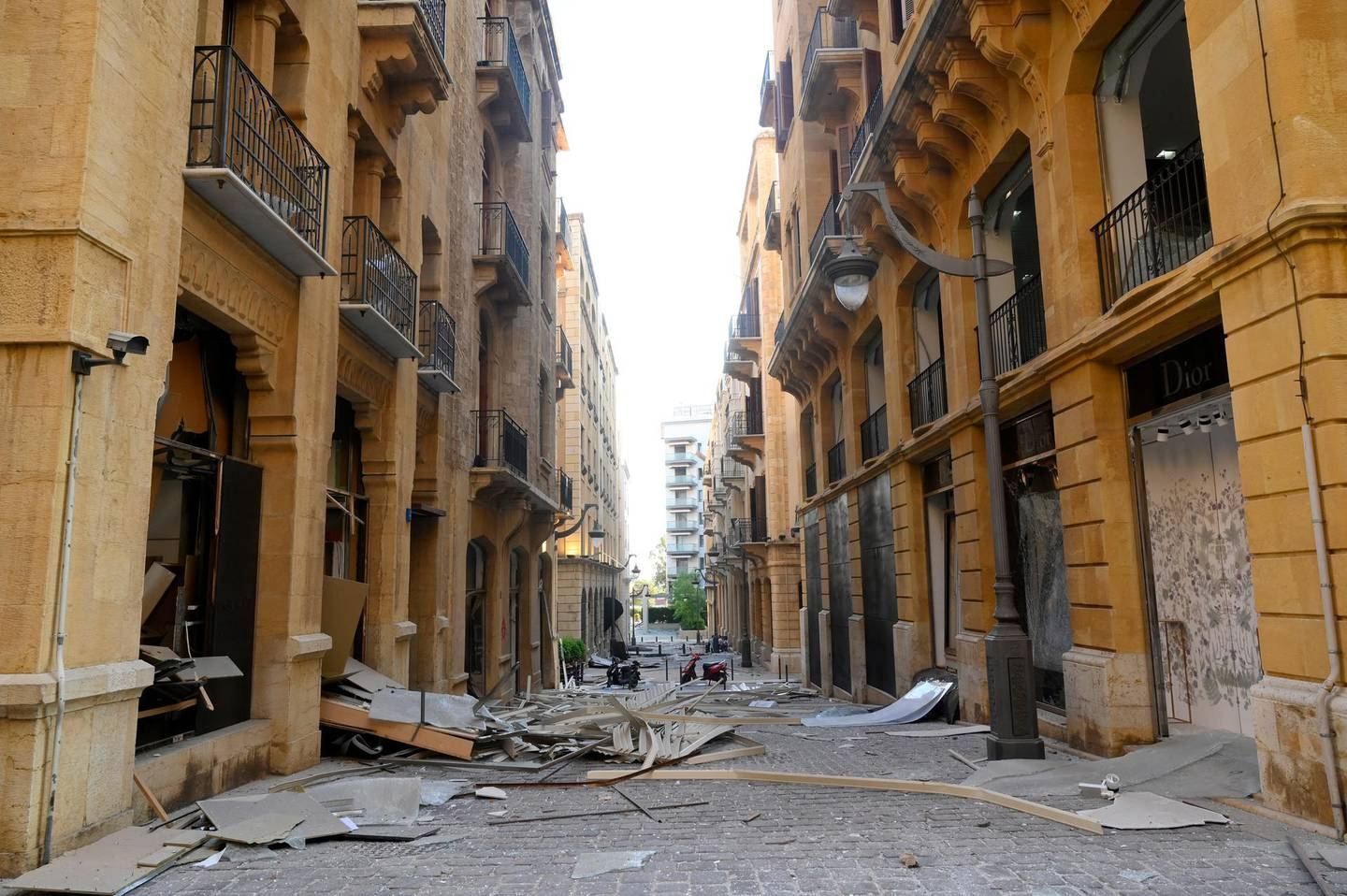 epa08584748 Damaged shops in the aftermath of a massive explosion in downtown Beirut, Lebanon, 05 August 2020. According to media reports, at least 100 people were killed and more than 4,000 were injured after an explosion, caused by over 2,500 tonnes of ammonium nitrate stored in a warehouse, devastated the port area on 04 August.  EPA/WAEL HAMZEH