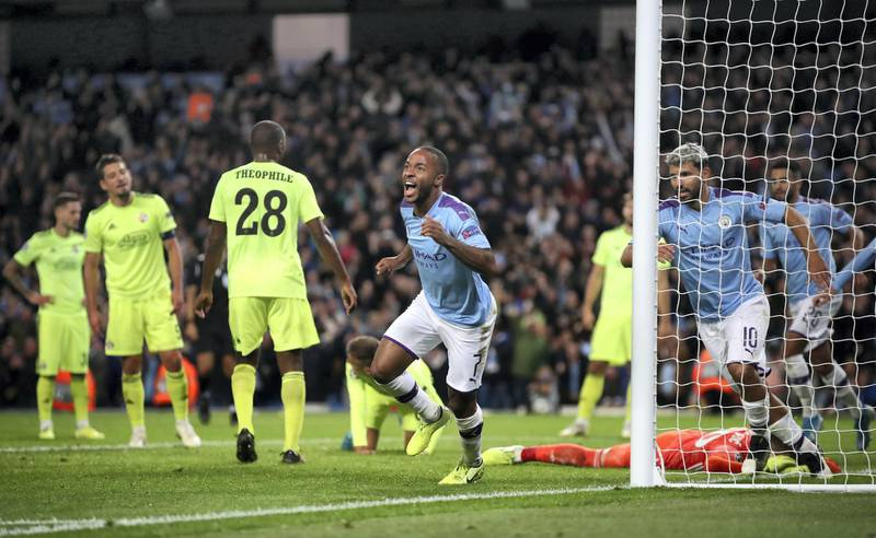Manchester City's Raheem Sterling celebrates scoring his side's first goal of the game during the UEFA Champions League match at the Etihad Stadium, Manchester.