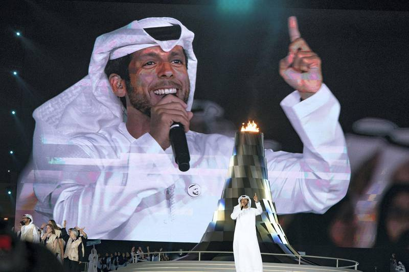 ABU DHABI, UNITED ARAB EMIRATES - March 21, 2019: Hamad Al Ameri (C) performs during the closing ceremony of the Special Olympics World Games Abu Dhabi 2019, at Zayed Sports City.   ( Hamad Al Mansoori for Ministry of Presidential Affairs ) ---