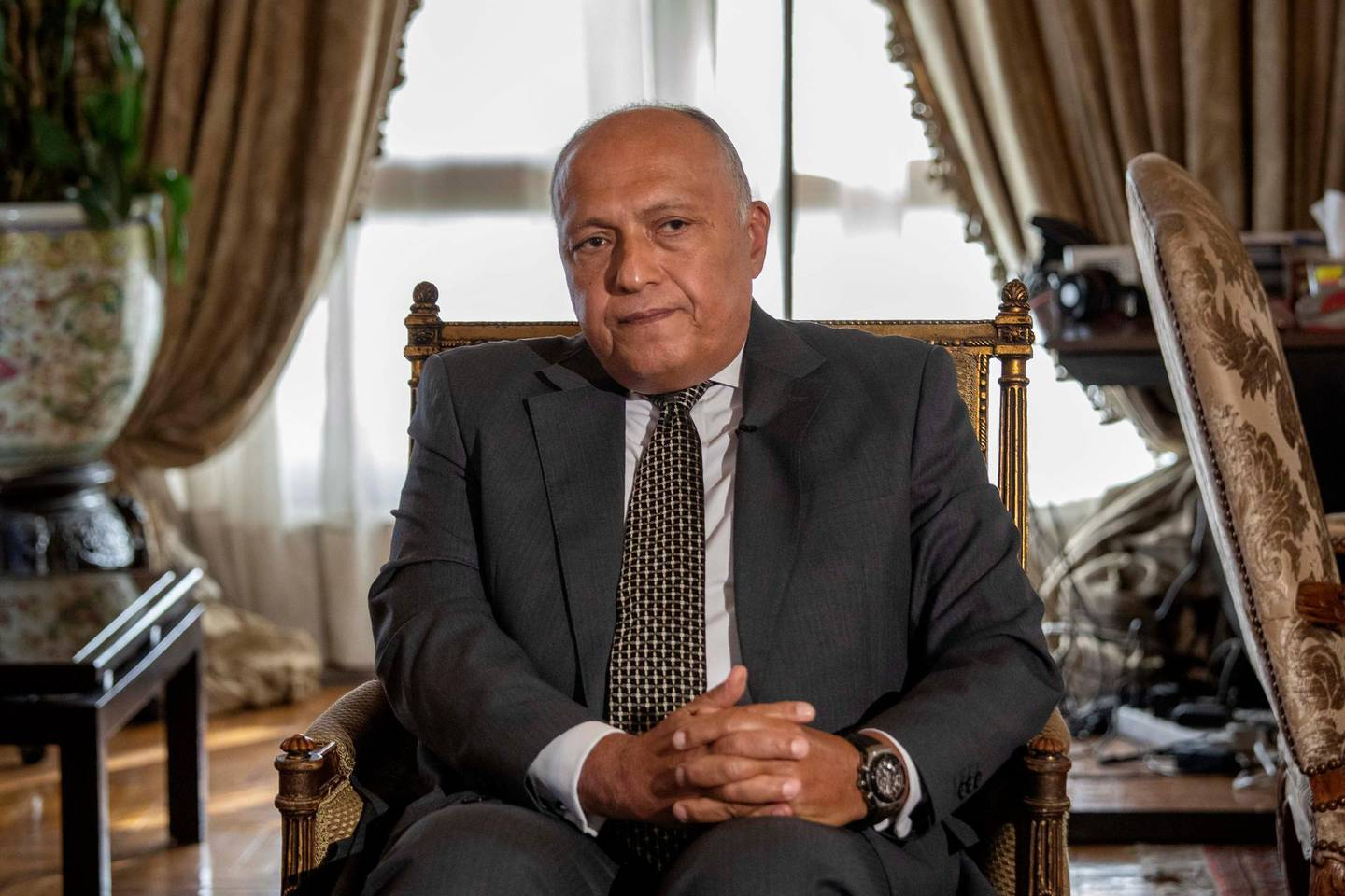"""Egyptian Foreign Minister Sameh Shukry listens during an interview with The Associated Press at his office, in Cairo, Egypt, Sunday, June 21, 2020. Egypt wants the United Nations Security Council to """"undertake its responsibilities"""" and prevent Ethiopia from starting to fill its massive, newly built hydroelectric dam on the Nile River next month amid a breakdown in negotiations, Shukry told The Associated Press on Sunday, accusing Ethiopian officials of stoking antagonism between the countries. (AP Photo/Nariman El-Mofty)"""