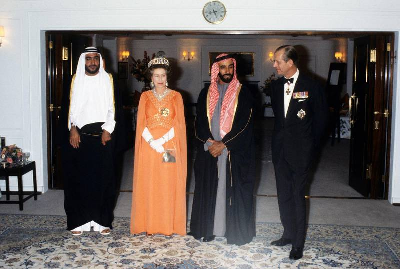 ABU DHABI, UNITED ARAB EMIRATES - FEBRUARY 25:  Queen Elizabeth ll and Prince Philip, Duke of Edinburgh entertain Sheikh Zayed of Abu Dhabi on board the Royal Yacht Britannia during a State Visit to the Gulf States on February 25, 1979 in the United Arab Emirates. (Photo by Anwar Hussein/Getty Images) *** Local Caption *** Queen Elizabeth II;Sheikh Zayed of Abu Dhabi;Prince Philip, Duke of Edinburgh