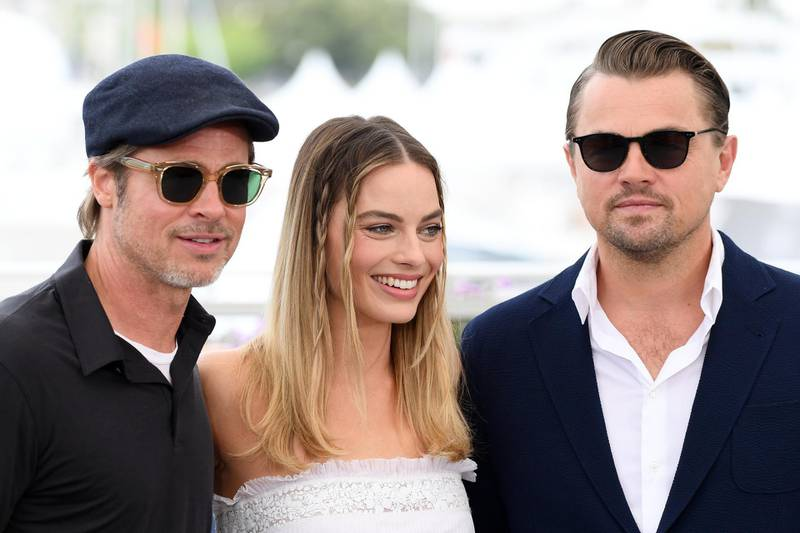 """CANNES, FRANCE - MAY 22: Brad Pitt, Margot Robbie and Leonardo DiCaprio attend thephotocall for """"Once Upon A Time In Hollywood""""  during the 72nd annual Cannes Film Festival on May 22, 2019 in Cannes, France. (Photo by Gareth Cattermole/Getty Images)"""
