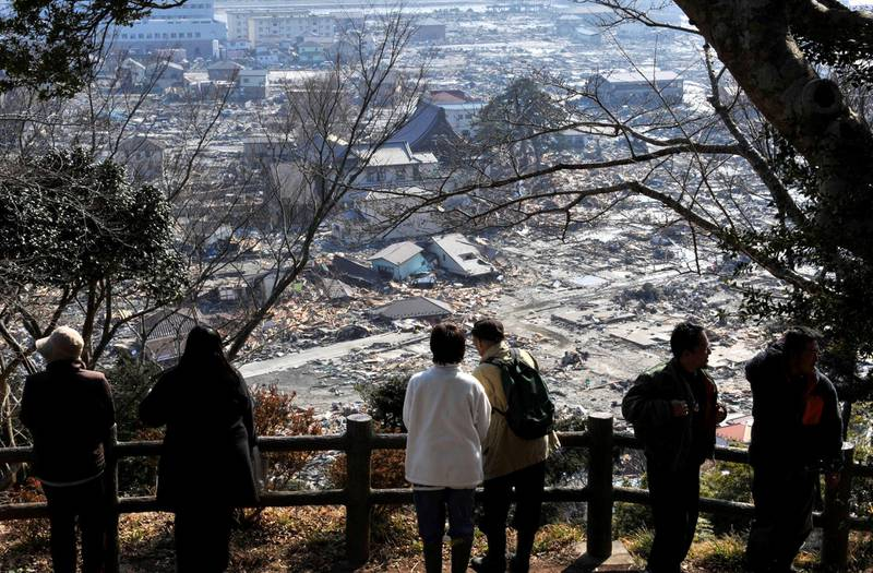 epa05201153 (15/39) (FILE) A file picture shows tsunami survivors look over the tsunami-devastated area of Ishinomaki in Miyagi Prefecture, about 270km north of Tokyo, northern Japan, 13 March 2011. March 11, 2016 marks the fifth  anniversary of the 9.0-magnitude earthquake and subsequent tsunami that devastated northeastern Japan and triggered a nuclear disaster at the Fukushima Daiichi Nuclear Power Plant.  EPA/KIMIMASA MAYAMA PLEASE REFER TO ADVISORY NOTICE (epa05201138) FOR FULL PACKAGE TEXT *** Local Caption *** 52635439