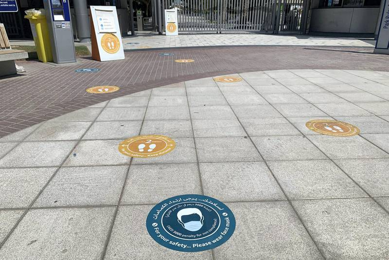 DUBAI, UNITED ARAB EMIRATES , October 10 – 2020 :- Face mask wearing sticker pasted on the floor at the entrance of the Zabeel park in Dubai. Stickers about Covid safety measures pasted all over the park for the visitors. (Pawan Singh / The National) For News/Stock/Online.