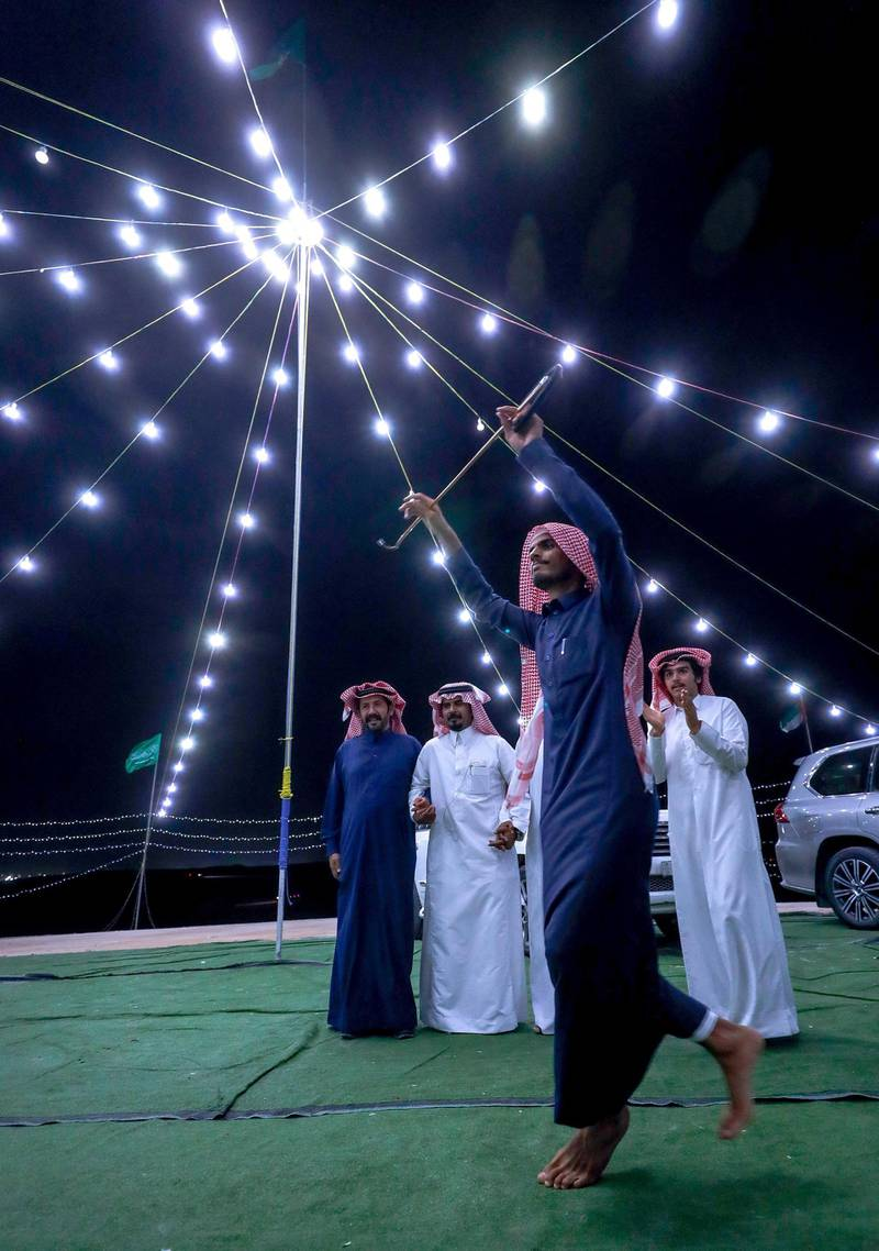 Abu Dhabi, United Arab Emirates, December 10, 2019.    -- Ali Qahtani celebrates the victory of a two year old camel at the Al Dhafra Festival in Abu Dhabi, UAE.Victor Besa/The NationalSection:  NAReporter:  Anna Zacharias