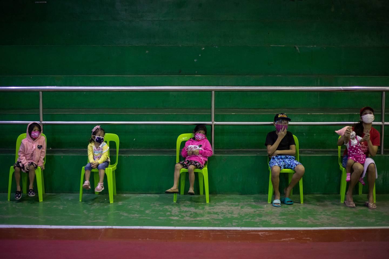Children queue for free coronavirus disease (COVID-19) swab testing at a gymnasium in Navotas City, Metro Manila, Philippines, August 7, 2020. REUTERS/Eloisa Lopez