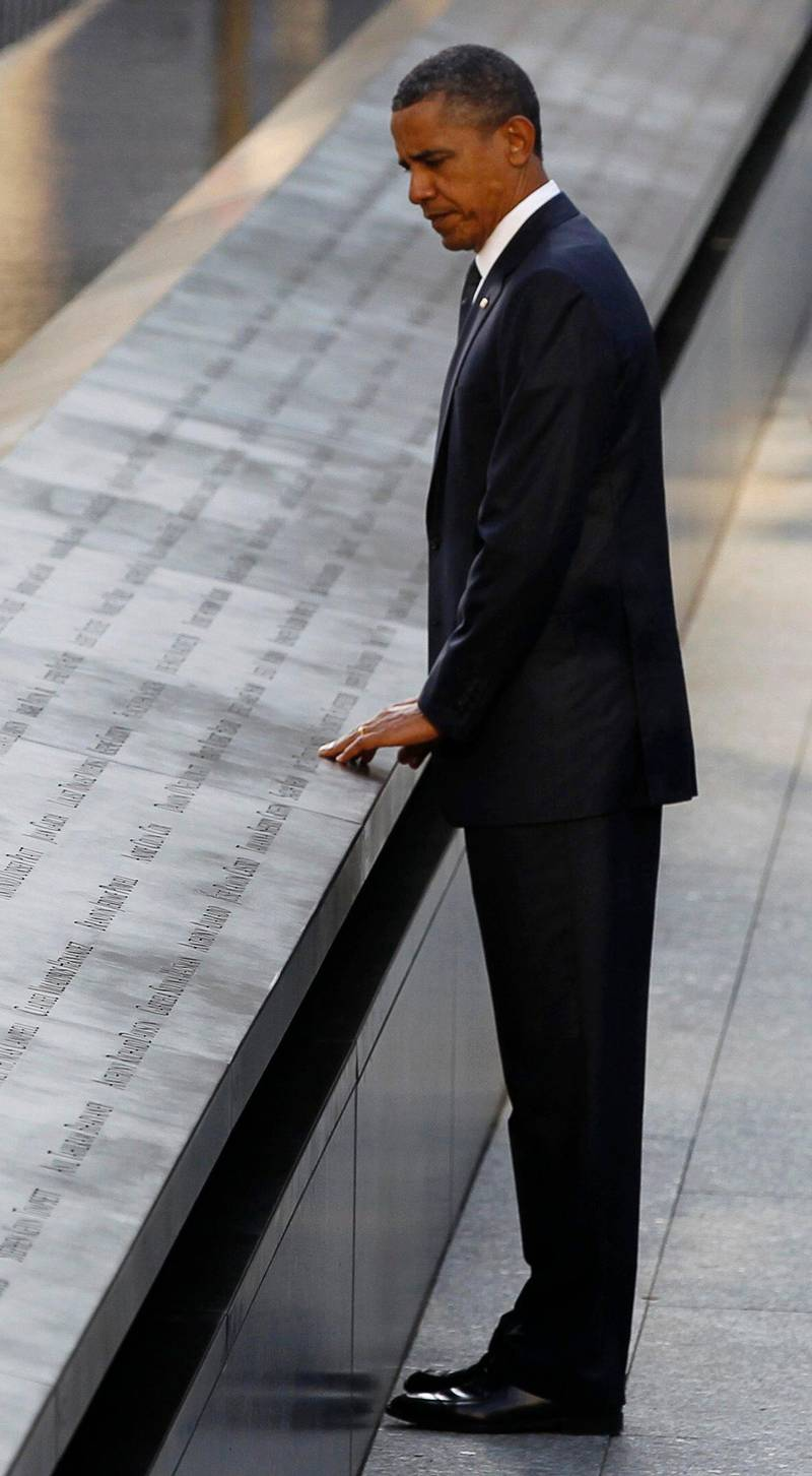 U.S. President Barack Obama touches the names of victims engraved on the side of the north pool of the World Trade Center site during ceremonies marking the 10th anniversary of the 9/11 attacks on the World Trade Center, in New York September 11, 2011.  REUTERS/Larry Downing (UNITED STATES - Tags: ANNIVERSARY DISASTER TPX IMAGES OF THE DAY) *** Local Caption ***  WTC617R_SEPT11-_0911_11.JPG