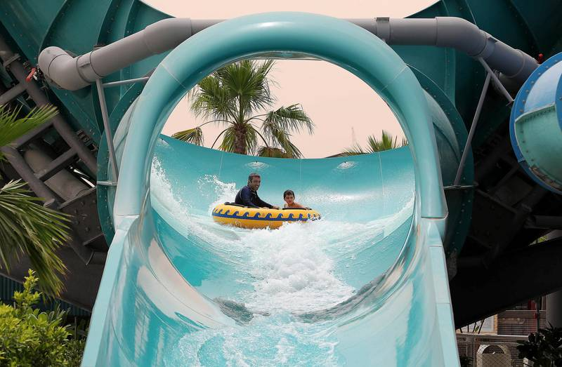 DUBAI , UNITED ARAB EMIRATES , MAY 12 – 2018 :- People taking water slides at the Laguna Waterpark in La Mer in Dubai.  ( Pawan Singh / The National )  For News/ Big Picture / Weekend. Story by Salam Al Amir