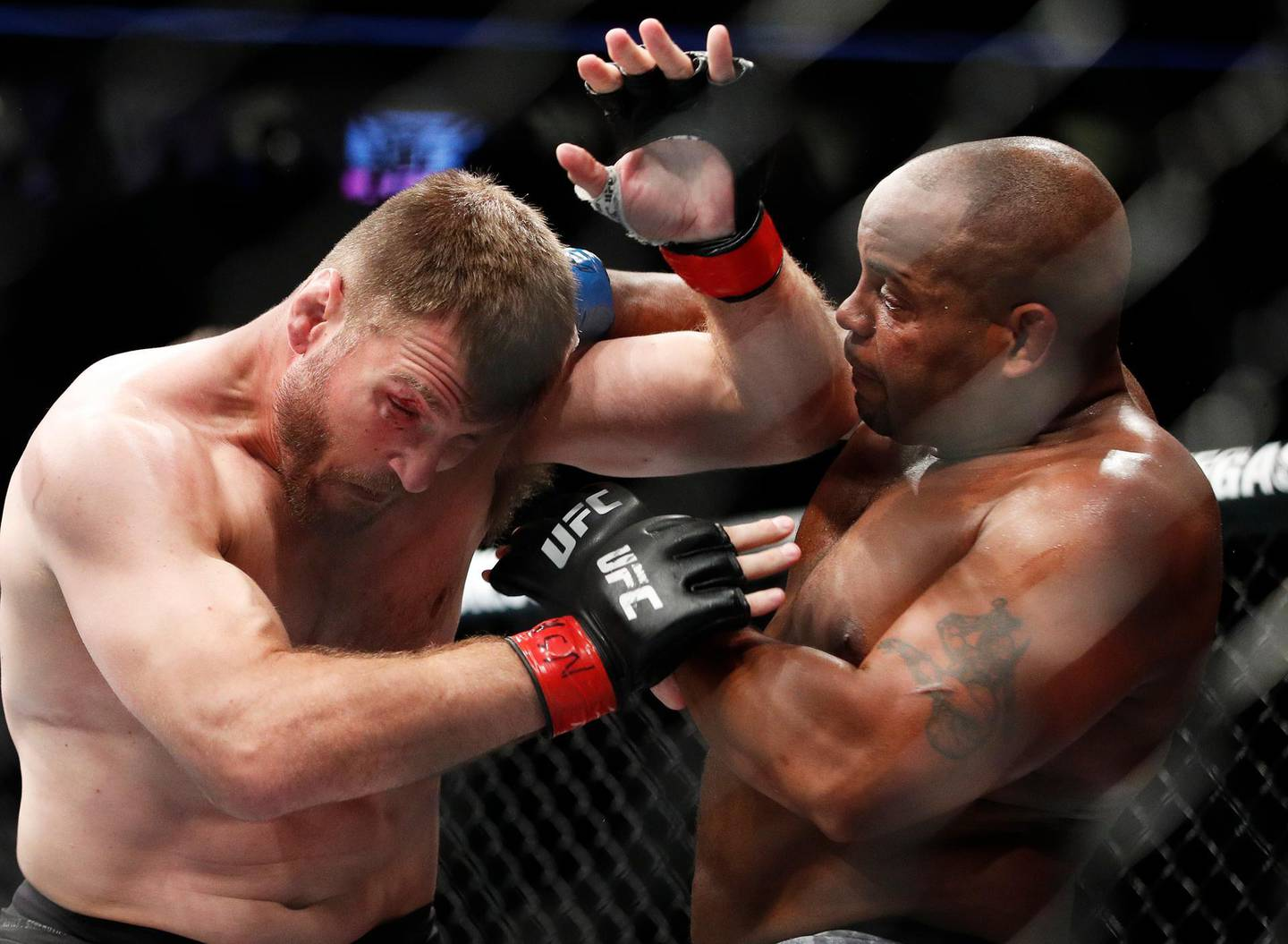 FILE - In this July 7, 2018, file photo, Daniel Cormier, right, fights Stipe Miocic during a heavyweight title mixed martial arts bout at UFC 226 in Las Vegas. The trilogy fight between Daniel Cormier and champ Stipe Miocic will crown the greatest heavyweight of all time. UFC 252 Saturday, Aug. 15, 2020, in Las Vegas could be Cormier's last fight ever. (AP Photo/John Locher, File)