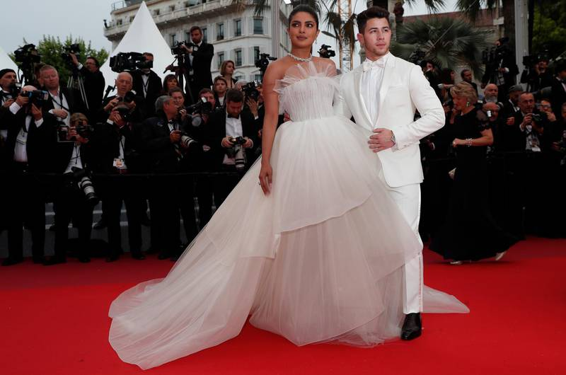 epa07582172 Priyanka Chopra (L) and Nick Jonas (R) arrive for the screening of 'Les Plus Belles Annees d'une Vie' (The Best Years of a Life) during the 72nd annual Cannes Film Festival, in Cannes, France, 18 May 2019. The movie is presented in the Official Competition of the festival which runs from 14 to 25 May.  EPA-EFE/IAN LANGSDON