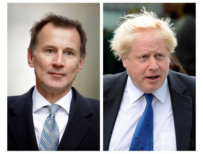 FILE - In this two photo file combo image, Jeremy Hunt, left, and Boris Johnson, right, who are the final two contenders for leadership of the Conservative Party, Thursday June 20, 2019. Following elimination votes Britain's Conservative Party members will vote for the final two contenders with the winner due to replace Prime Minister Theresa May as party leader and prime minister. (AP Photo FILE/Matt Dunham, Frank Augstein)