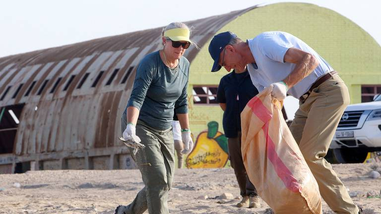 An image that illustrates this article US ambassador to Kuwait helps out on World Cleanup Day - in pictures