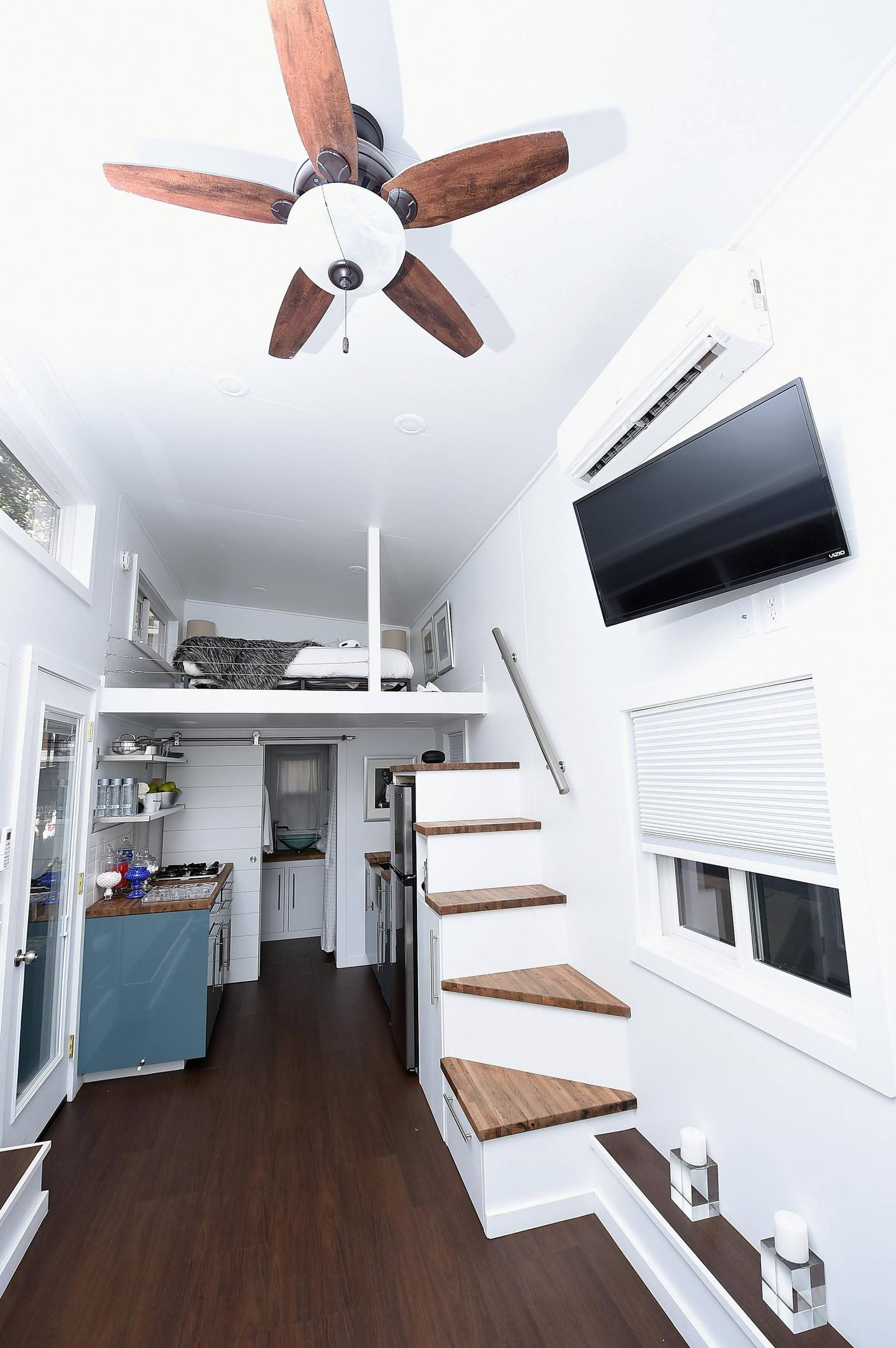 """NEW YORK, NY - SEPTEMBER 27: An interior view of the Tiny House during Booking.com's """"Tiny House With Big Personality"""" Curated By Kevin Hart on September 27, 2018 in New York City.   Michael Loccisano/Getty Images for Booking.com/AFP"""