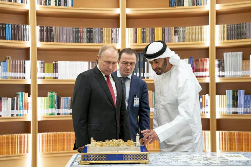 ABU DHABI, UNITED ARAB EMIRATES - October 15, 2019: HH Sheikh Mohamed bin Zayed Al Nahyan, Crown Prince of Abu Dhabi and Deputy Supreme Commander of the UAE Armed Forces (R) and HE Vladimir Putin Vladimirovich, President of Russia (L), exchange gifts during a state visit at Qasr Al Watan.( Mohamed Al Hammadi / Ministry of Presidential Affairs )---