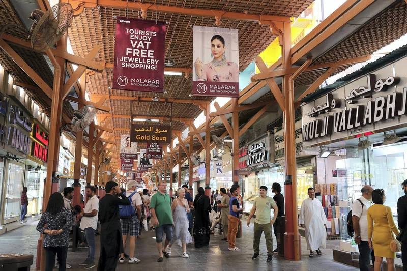 DUBAI , UNITED ARAB EMIRATES , Mar 10 – 2020 :- Tourists at the Dubai Gold Souk in Deira Dubai. ( Pawan Singh / The National ) For News/Online. Then and Now series