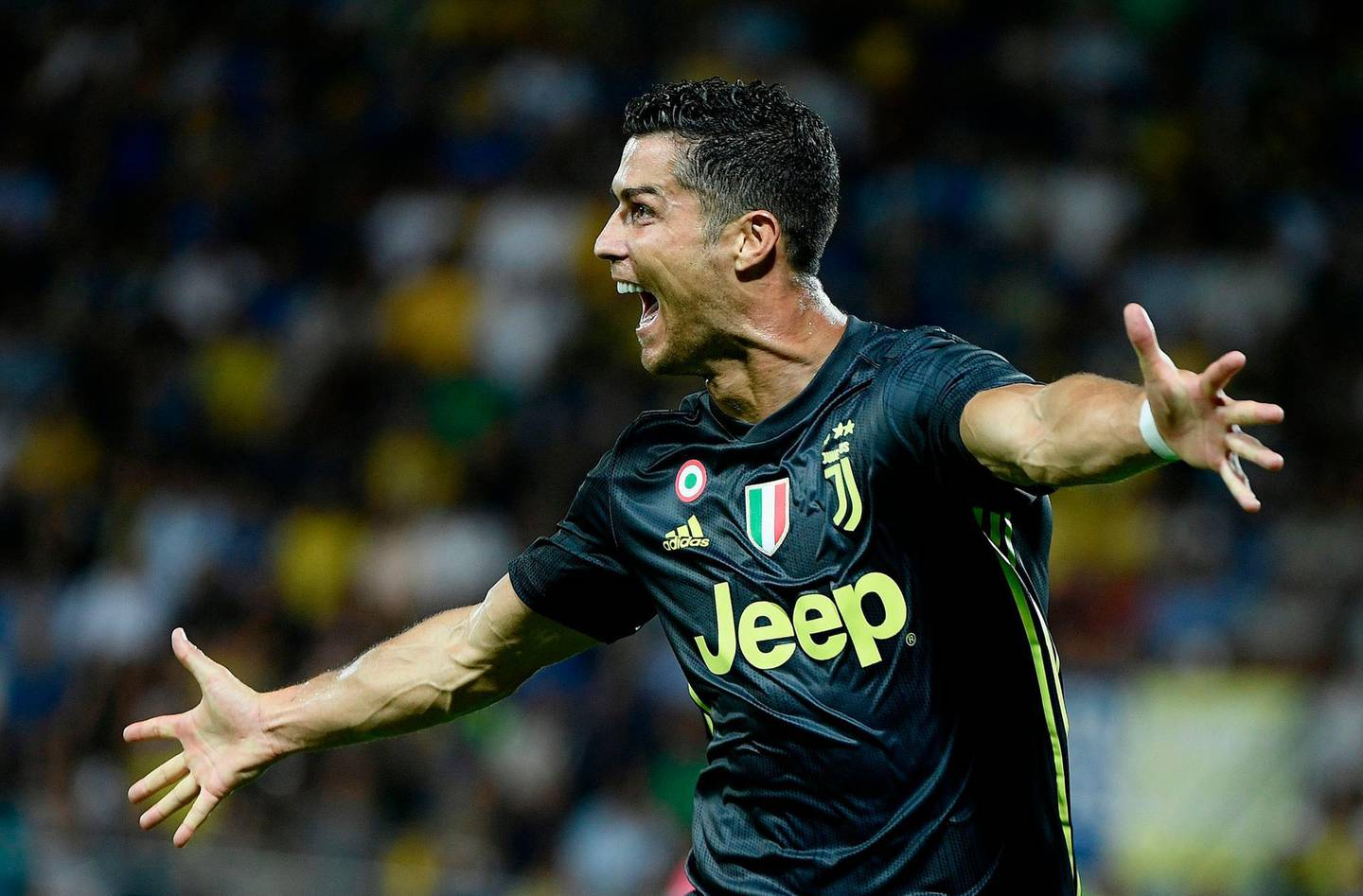 Juventus' Portuguese forward Cristiano Ronaldo celebrates after he scored during the Italian Serie A football match between Frosinone and Juventus Turin on September 23, 2018 at the Benito-Stirpe Stadium in Frosinone.  / AFP / Filippo MONTEFORTE