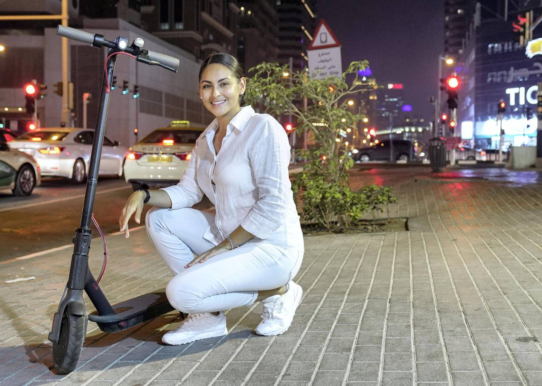 Dubai, United Arab Emirates, August 1, 2019.  Genesis Martinez, owner of an e-scooter at Dubai.   Victor Besa/The NationalSection:  NAReporter:  Haneen Dajani