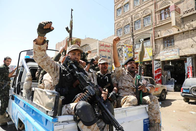 Houthi troops ride on the back of a police patrol truck after participating in a Houthi gathering in Sanaa, Yemen February 19, 2020. REUTERS/Khaled Abdullah