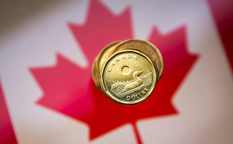 """FILE PHOTO: A Canadian dollar coin, commonly known as the """"Loonie"""", is pictured in this illustration picture taken in Toronto, January 23, 2015.    REUTERS/Mark Blinch (CANADA - Tags: BUSINESS)/File Photo"""