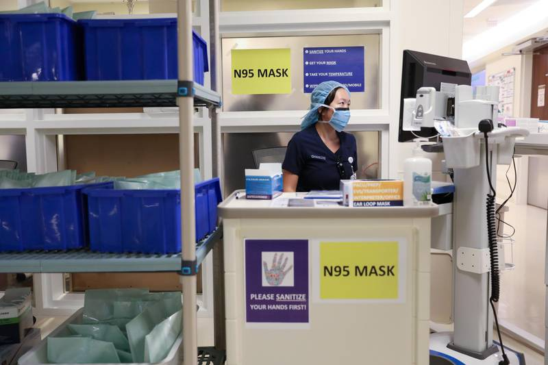 A member of medical staff wearing a protective face mask, works at an N95 face mask collection point, amid the coronavirus disease (COVID-19) outbreak, at the Cleveland Clinic hospital in Abu Dhabi, United Arab Emirates, April 20, 2020. Picture taken April 20, 2020.  REUTERS/Christopher Pike