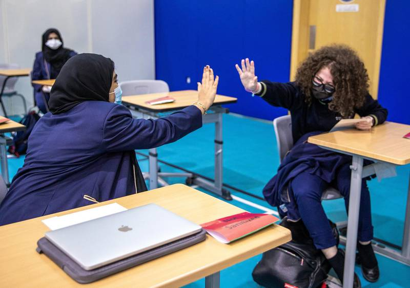 Abu Dhabi, United Arab Emirates, March 3, 2021.  Pupils receive some of their IGCSE and International A-level results for January session 2021. Pupils celebrating after recieving receiving results.Victor Besa / The NationalSection:  NAReporter:  Anam Rizvi