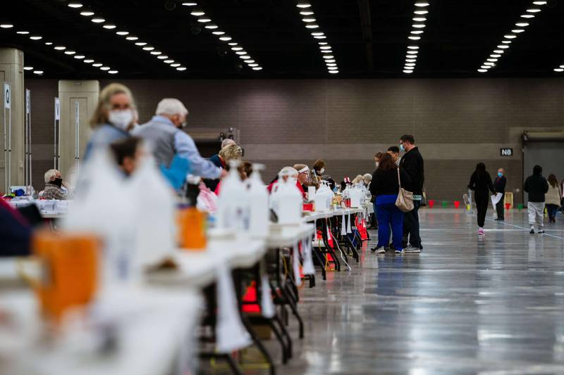 LOUISVILLE, KY - NOVEMBER 03: Election officials wait near a long line of hand sanitizer bottles at the Kentucky Exposition Center on November 3, 2020 in Louisville, Kentucky. After a record-breaking early voting turnout, Americans head to the polls on the last day to cast their vote for incumbent U.S. President Donald Trump or Democratic nominee Joe Biden in the 2020 presidential election.   Jon Cherry/Getty Images/AFP == FOR NEWSPAPERS, INTERNET, TELCOS & TELEVISION USE ONLY ==