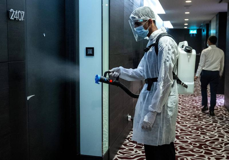 Abu Dhabi, United Arab Emirates, July 12, 2020.   Sofitel Abu Dhabi Corniche Hotel with updated Covid-19 precautionary measures.  A cleaner sanitises a walkway leading to the hotel rooms.Victor Besa  / The NationalSection:  StandaloneReporter: