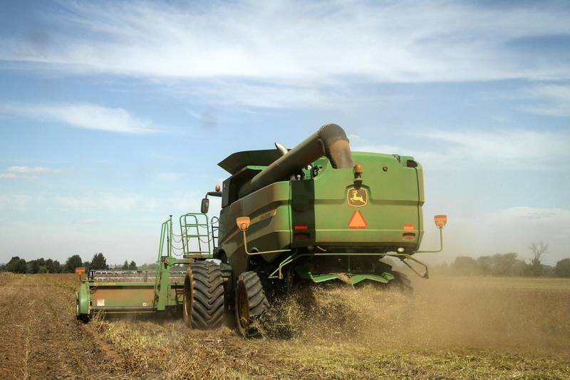 A John Deere S660 combine harvester, manufactured by Deere & Co., harvests a crop of soybean plants in a field in Delmas, South Africa, on Tuesday, April 8, 2014. South African corn stockpiles probably will more than double in 2014-15 after the government predicted this season's harvest will be the biggest since 1981. Photographer: Dean Hutton/Bloomberg