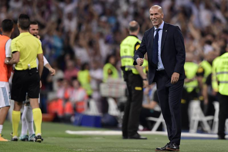 Real Madrid's French coach Zinedine Zidane celebrates their opener during the second leg of the Spanish Supercup football match Real Madrid vs FC Barcelona at the Santiago Bernabeu stadium in Madrid, on August 16, 2017. / AFP PHOTO / JAVIER SORIANO
