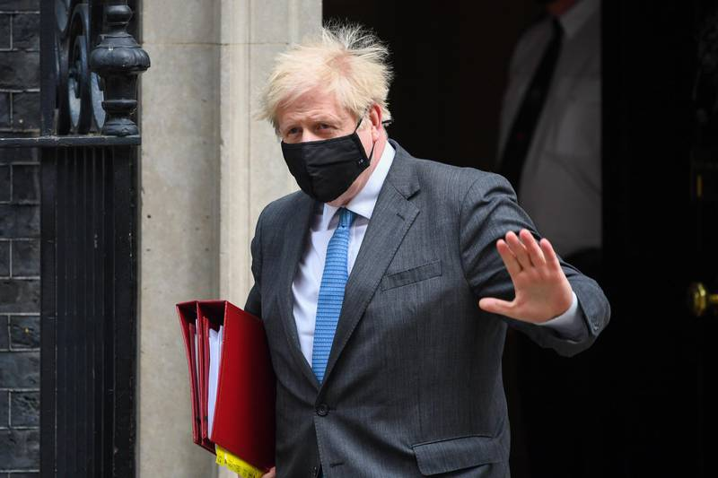 Boris Johnson, U.K. prime minister, departs from number 10 Downing Street on his way to Parliament in London, U.K., on Wednesday, April 28, 2021. Johnson may be mired in allegations of sleaze and cronyism in his U.K. government, yet members of his ruling Conservative Party say voters remain unmoved by the furor ahead of key elections next week. Photographer: Chris J. Ratcliffe/Bloomberg
