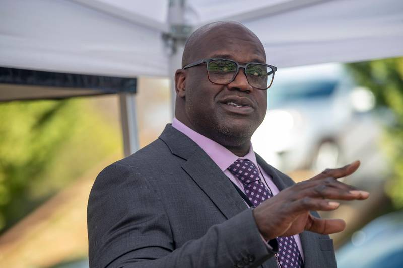 Basketball Hall of Famer Shaquille O'Neal speaks at a press conference in McDonough, Ga., Friday, Jan. 22, 2021, after being named Henry County Sheriff's Office Director of Community Relations by Henry County Sheriff Reginald Scandrett.  (Alyssa Pointer/Atlanta Journal-Constitution via AP)