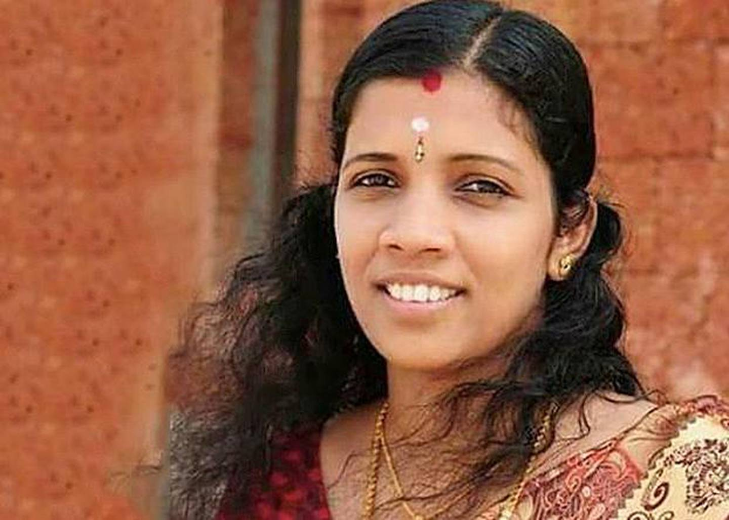 Lini Puthussery, nurse who died in Kerala two years ago treating patients affected by the Nipah virus. Her memory remains even as Malayalees battle the coronavirus. courtesy: Lini Puthissery face book