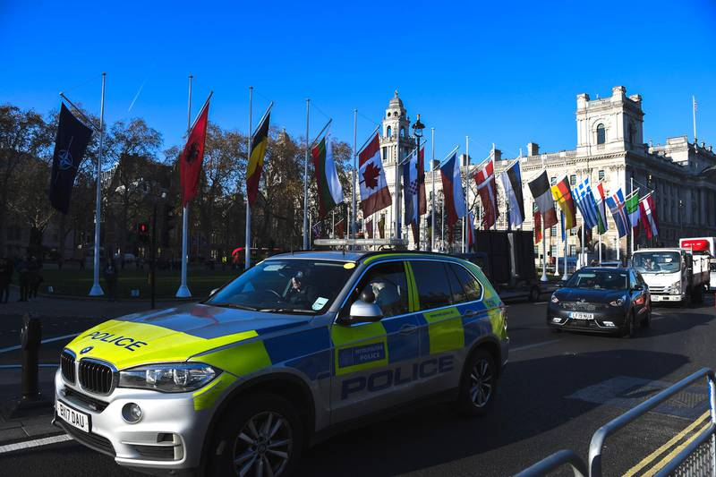 A police car drives past Parliament Square, ahead of the NATO summit, in London, Monday, Dec. 2, 2019. NATO leaders will gather in London on Tuesday as the world's biggest military alliance, marking its 70th birthday, battles with one of the most confounding of adversaries: Itself. (AP Photo/Alberto Pezzali)
