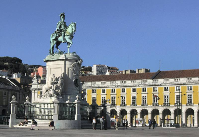 LISBON, PORTUGAL - JULY 23:  Tourists walk by a statue of Jose I at Praca de Comercio on July 23, 2008 in Lisbon, Portugal. Portugal is becoming an increasingly popular tourist destination.  (Photo by Sean Gallup/Getty Images)