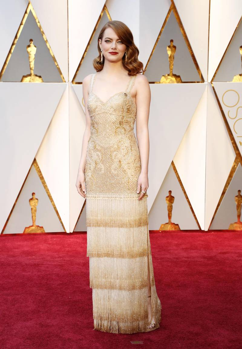 epa05817561 Emma Stone arrives for the 89th annual Academy Awards ceremony at the Dolby Theatre in Hollywood, California, USA, 26 February 2017. The Oscars are presented for outstanding individual or collective efforts in 24 categories in filmmaking.  EPA/MIKE NELSON