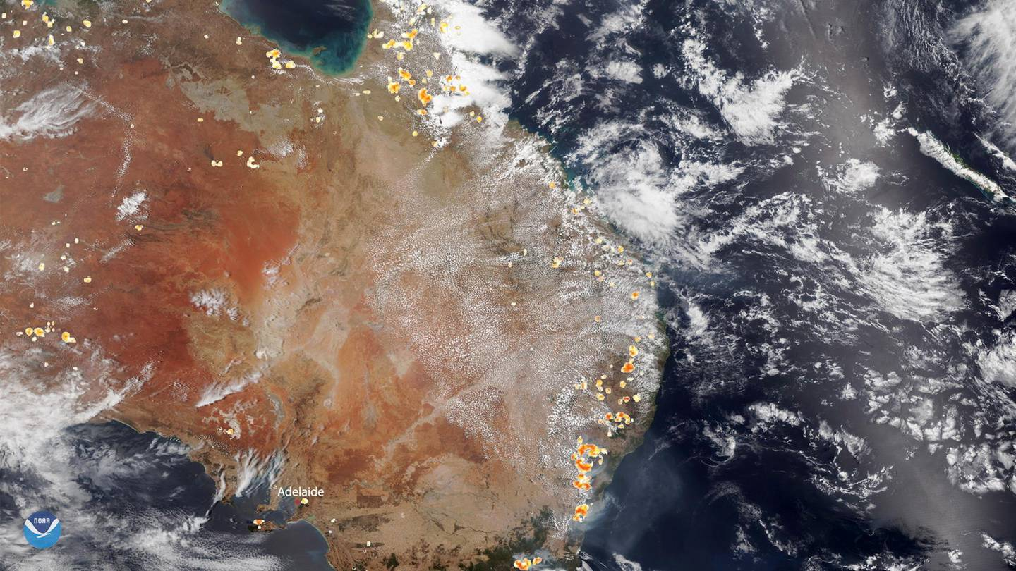 epa08092338 A handout photo made available by the National Oceanic and Atmospheric Administration (NOAA) of a satellite image showing part of mainland Australia, 26 December 2019, where historic bushfires still rage in the southeastern states and territories, especially intense around the South Australian city of Adelaide (L, bottom). Meanwhile, fires around Sydney have mostly been brought under control, but the New South Wales Rural Fire Service (NSWRFS) advised affected residents that weather conditions are forecast to deteriorate over the coming days. This image was captured by the NOAA-20 satellite's VIIRS instrument, which scans the entire Earth twice per day.  EPA/NOAA HANDOUT  HANDOUT EDITORIAL USE ONLY/NO SALES