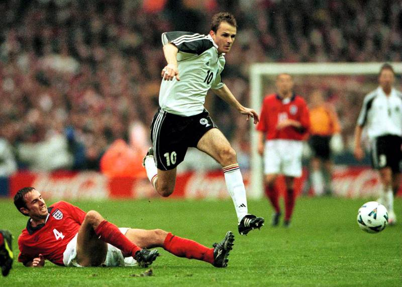 7 Oct 2000:  Dietmar Hamann of Germany jumps the tackle of Gareth Southgate of England during the match between England and Germany in the European Group Nine World Cup Qualifier at Wembley Stadium, London.  Mandatory Credit: Phil Cole/ALLSPORT