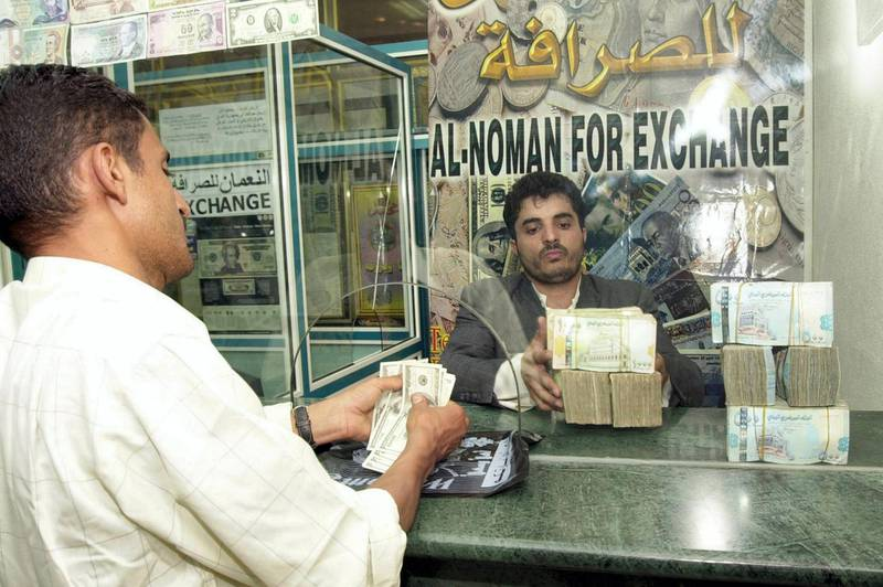 A Yemeni man exchanges money in Sanaa 26 June 2005. The Yemeni currency started last month gradually its collapsing in front of the foreign hard currency, but during the last few days it rabidly fell down, with the US Dollar price rising today up to 196 Riyals, which is the highest price for Dollar in the history of Yemeni Riyal. AFP PHOTO/KHALED FAZAA / AFP PHOTO / KHALED FAZAA