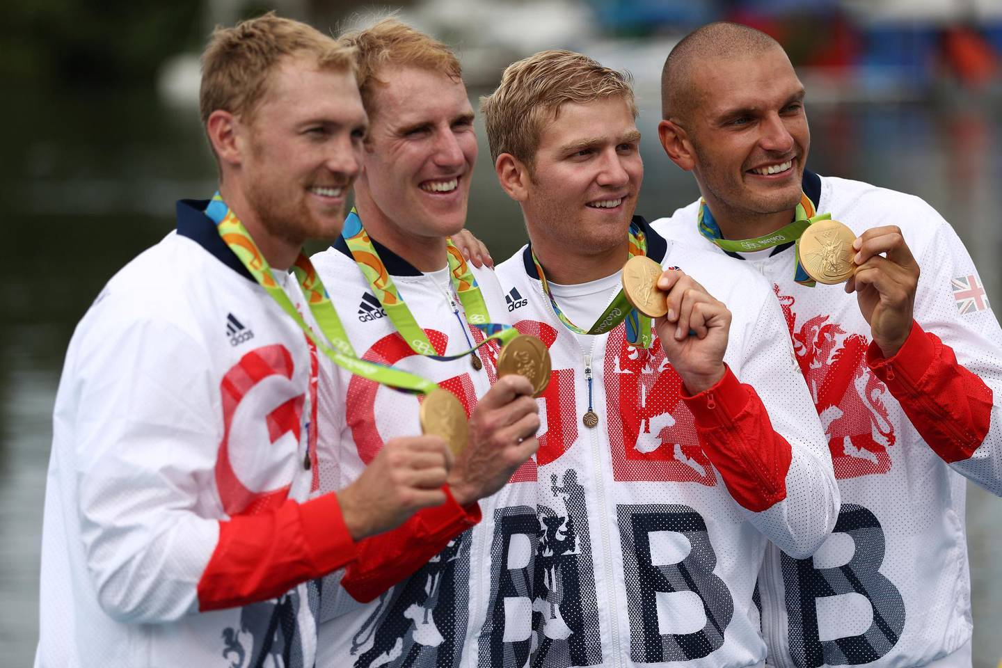 RIO DE JANEIRO, BRAZIL - AUGUST 12:  Gold medalists Alex Gregory, Mohamed Sbihi, George Nash and Constantine Louloudis of Great Britain pose for photographs on the podium at the medal ceremony for the Men's Four on Day 7 of the Rio 2016 Olympic Games at Lagoa Stadium on August 12, 2016 in Rio de Janeiro, Brazil.  (Photo by Patrick Smith/Getty Images)